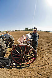 Farmer filling seed drill with oats
